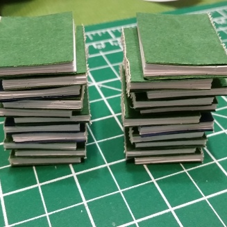 Tiny stack of finished text blocks